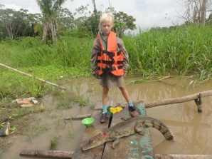 we came upon an indigenous family who had caught a small crocodile